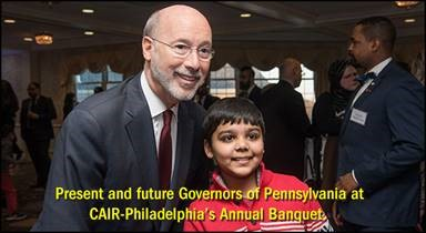 Governor Tom Wolf and banquet attendee.