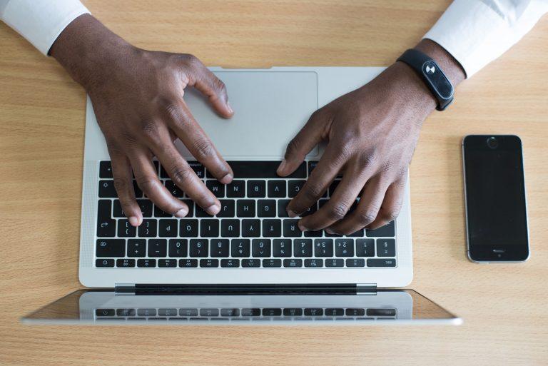 Hands On a Laptop. Photo by Cytonn Photography on Unsplash