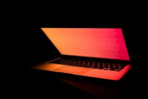 Glowing Laptop in the Dark Photo by Filiberto Santillán on Unsplash