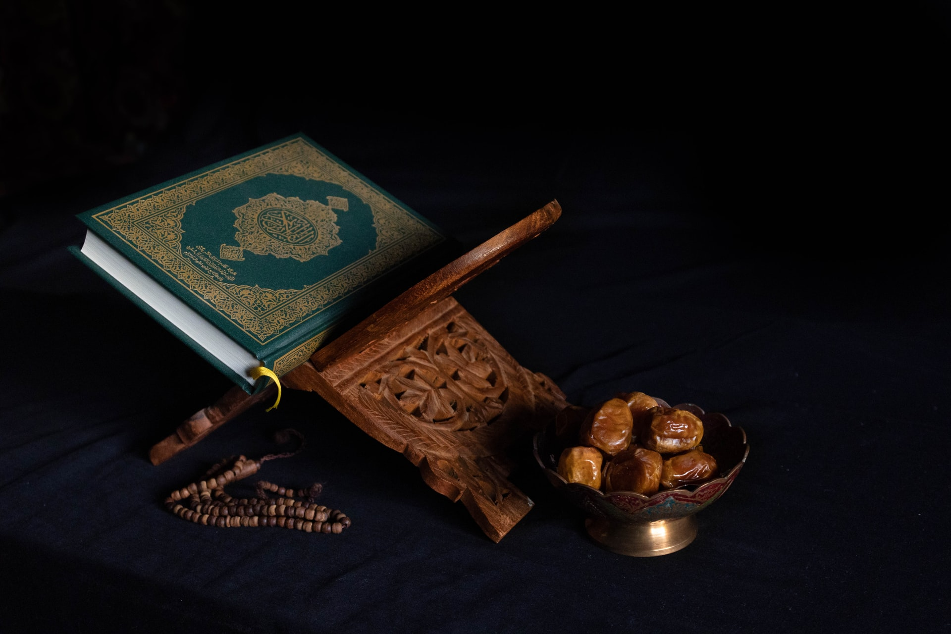 Quran and Dates by Abdullah Arif on Unsplash