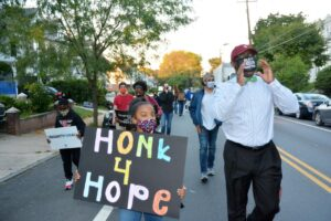 The Rev. James Buck, senior pastor of Grace Baptist Church of Germantown, leads a social justice march down Germantown Avenue last in October 2020. — TRIBUNE FILE PHOTO
